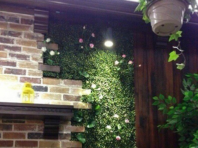 Artificial plant hedges for green wall--interior wall of hotel or restaurant
