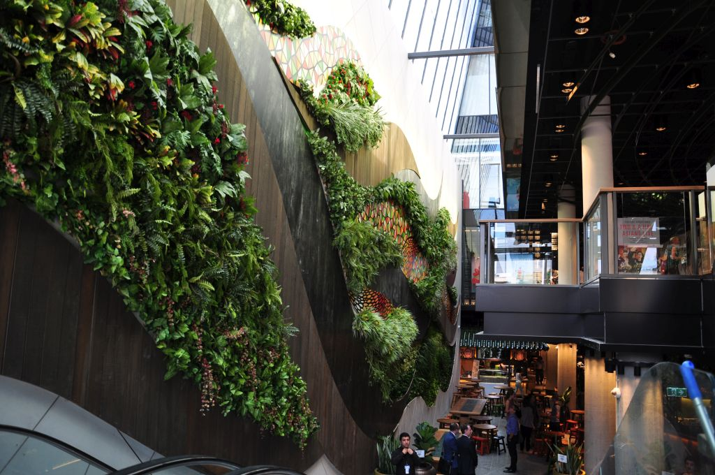 artificial plants wall in a large shopping hall